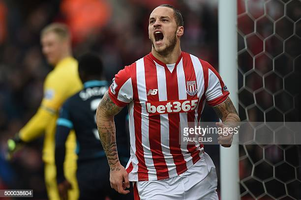 Stoke City's Austrian striker Marko Arnautovic celebrates after scoring during the English Premier League football match between Stoke City and...