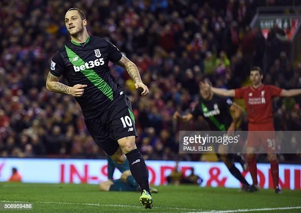 Stoke City's Austrian striker Marko Arnautovic celebrates after scoring the opening goal as Liverpool's English defender Jon Flanagan appeals for...
