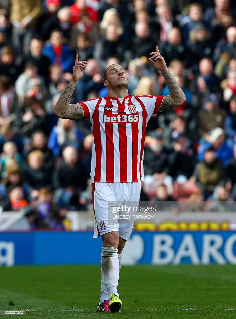 Stoke City's Austrian striker Marko Arnautovic celebrates scoring the opening goal during the English Premier League football match between Stoke City and Sunderland at the Britannia Stadium in Stoke-on-Trent, central England on April 30, 2016. / AFP / LINDSEY PARNABY / RESTRICTED TO EDITORIAL USE. No use with unauthorized audio, video, data, fixture lists, club/league logos or 'live' services. Online in-match use limited to 75 images, no video emulation. No use in betting, games or single club/league/player publications. /