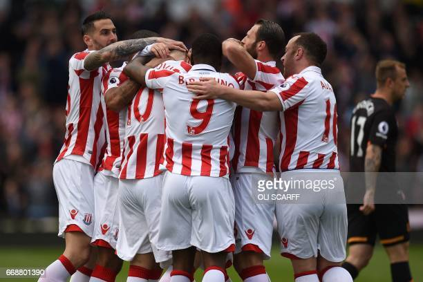 Stoke City's Austrian striker Marko Arnautovic celebrates with teammates after scoring the opening goal during the English Premier League football...
