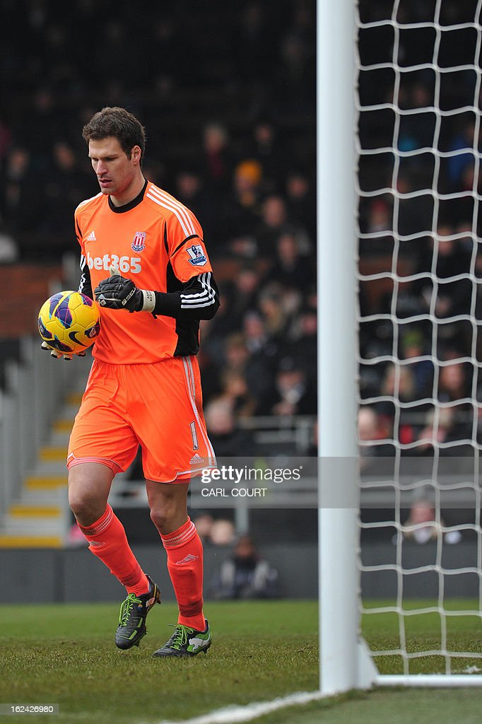 """Stoke City's Bosnian goalkeeper Asmir Begovic gathers the ball during the English Premier League football match between Fulham and Stoke City at Craven Cottage in London on February 23, 2013. Fulham won the game 1-0. AFP PHOTO/CARL COURT USE. No use with unauthorized audio, video, data, fixture lists, club/league logos or """"live"""" services. Online in-match use limited to 45 images, no video emulation. No use in betting, games or single club/league/player publications"""