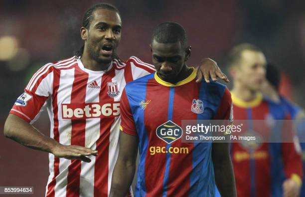 Stoke City's Cameron Jerome leaves the pitch with Crystal Palace's Yannick Bolasie after winning 41 during the FA Cup Third Round Replay at the...