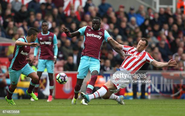Stoke City's Charlie Adam challenges West Ham United's Cheikhou Kouyate during the Premier League match between Stoke City and West Ham United at...