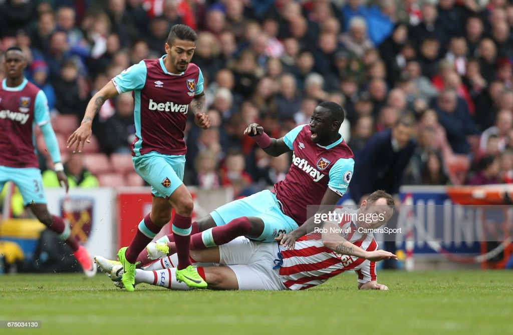 Stoke City's Charlie Adam challenges West Ham United's Cheikhou Kouyate during the Premier League match between Stoke City and West Ham United at Bet365 Stadium on April 29, 2017 in Stoke on Trent, England.
