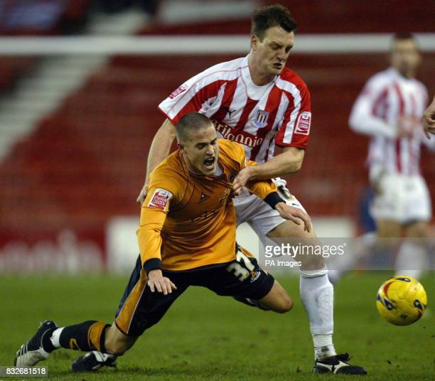 Stoke City's Clint Hill and Wolves' Michael Kightly battle during the CocaCola Championship match at the Britannia Stadium Stoke