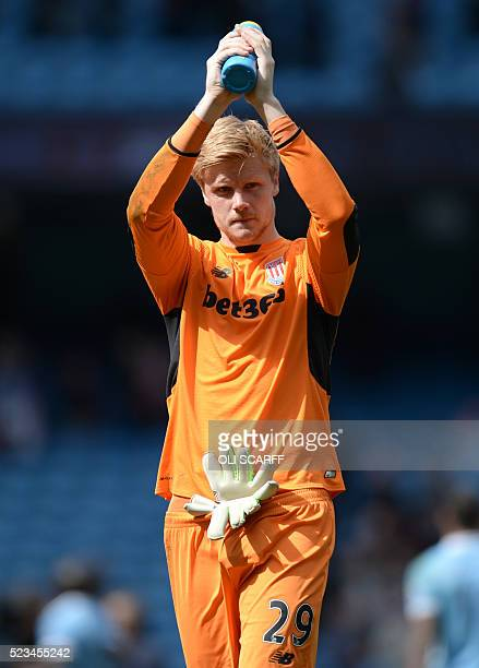Stoke City's Danish goalkeeper Jakob Haugaard applauds supporters after the English Premier League football match between Manchester City and Stoke...