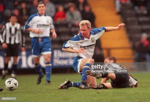 Stoke City's David Oldfield is tackled by Notts County's Shaun Murray