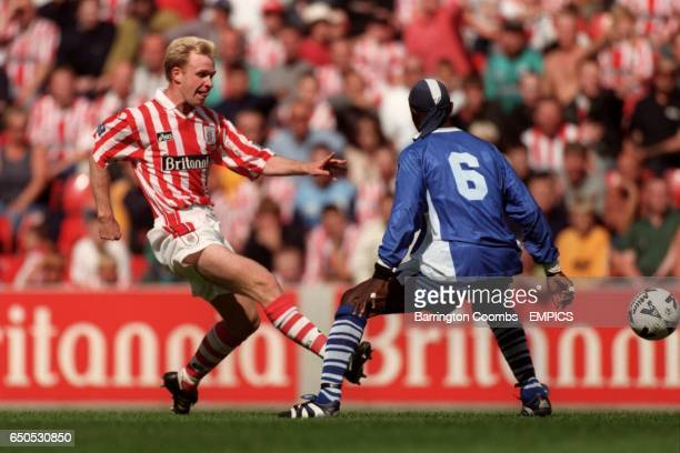 Stoke City's David oldfield plays the ball past Macclesfield Town's Efetobore Sodje