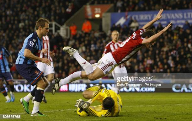 Stoke City's Dean Whitehead falls over his own goalkeeper Asmir Begovic in the penalty area