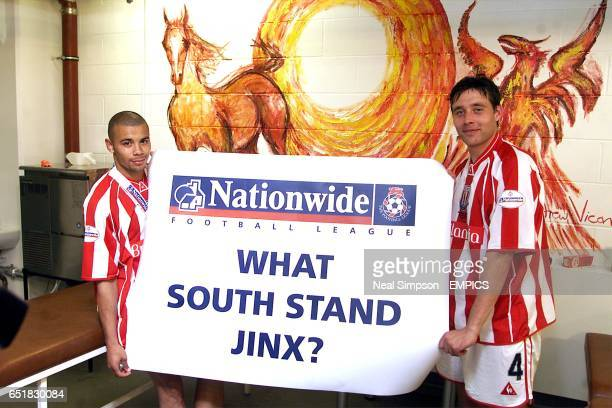 Stoke City's Deon Burton and Peter Handyside hold a banner regarding the South Stand jinx after their 20 win over Brenford