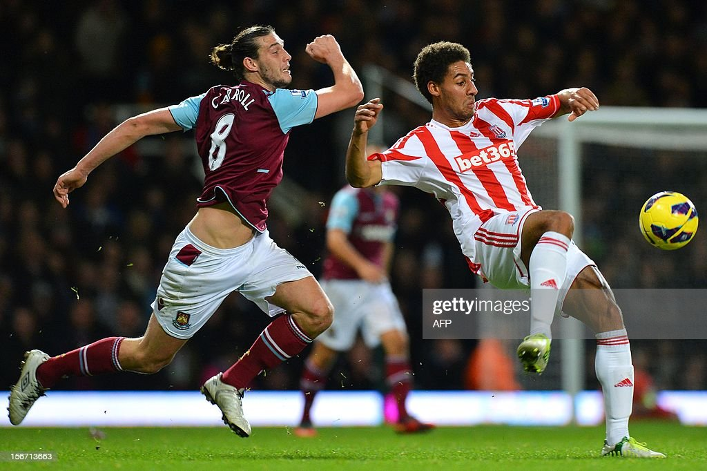 "Stoke City's English defender Ryan Shotton (R) vies for the ball with West Ham United's English midfielder Andy Carroll (L) during the English Premier League football match between West Ham and Stoke City at the Boleyn Ground, Upton Park, in East London, England, on November 19, 2012. The match ended in a 1-1 draw. USE. No use with unauthorized audio, video, data, fixture lists, club/league logos or ""live"" services. Online in-match use limited to 45 images, no video emulation. No use in betting, games or single club/league/player publications."