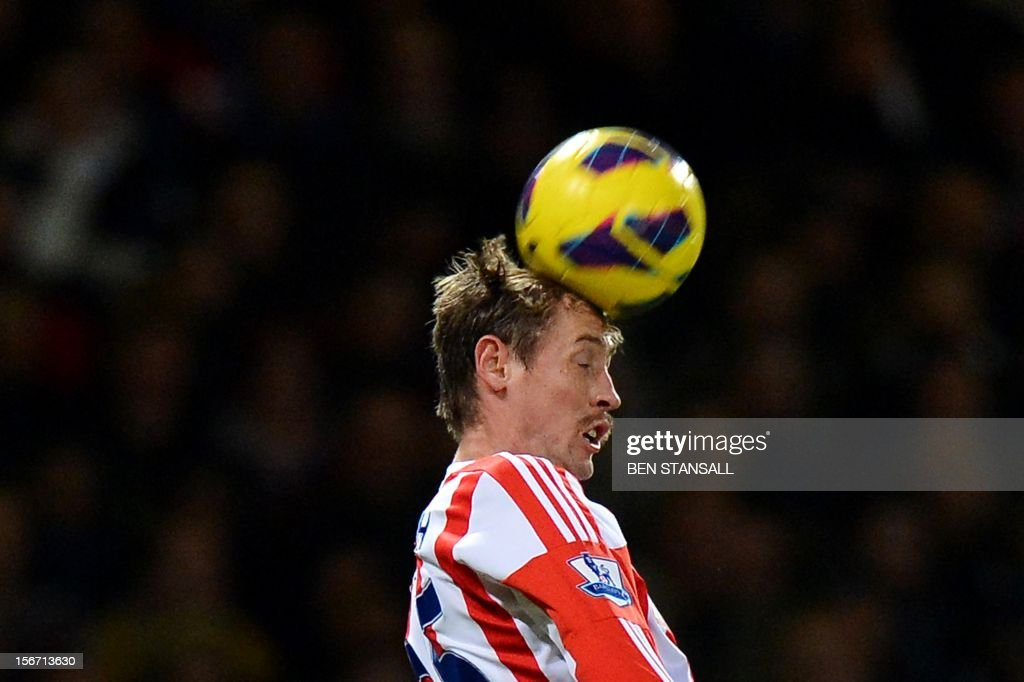 "Stoke City's English forward Peter Crouch jumps for the ball during the English Premier League football match between West Ham and Stoke City at the Boleyn Ground, Upton Park, in East London, England, on November 19, 2012. The match ended in a 1-1 draw. USE. No use with unauthorized audio, video, data, fixture lists, club/league logos or ""live"" services. Online in-match use limited to 45 images, no video emulation. No use in betting, games or single club/league/player publications."