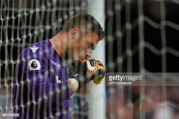 Stoke City's English goalkeeper Jack Butland is seen during the English Premier League football match between Manchester City and Stoke City at the...