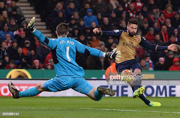 TOPSHOT Stoke City's English goalkeeper Jack Butland jumps to save a shot from Arsenal's French striker Olivier Giroud during the English Premier...