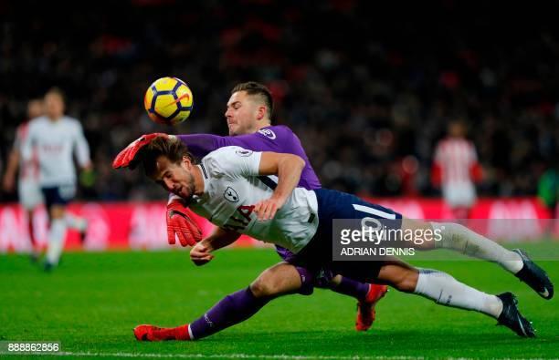 Stoke City's English goalkeeper Jack Butland manages to prevent Tottenham Hotspur's English striker Harry Kane scoring during the English Premier...