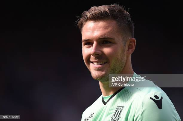 Stoke City's English goalkeeper Jack Butland reacts during the English Premier League football match between Everton and Stoke City at Goodison Park...