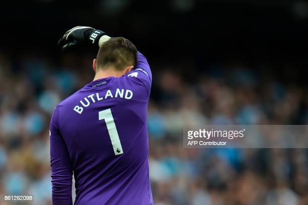 Stoke City's English goalkeeper Jack Butland reacts during the English Premier League football match between Manchester City and Stoke City at the...