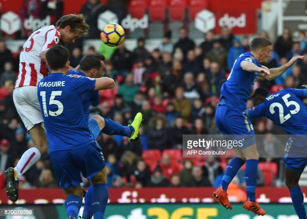 Stoke City's English striker Peter Crouch climbs to head home their second goal during the English Premier League football match between Stoke City...