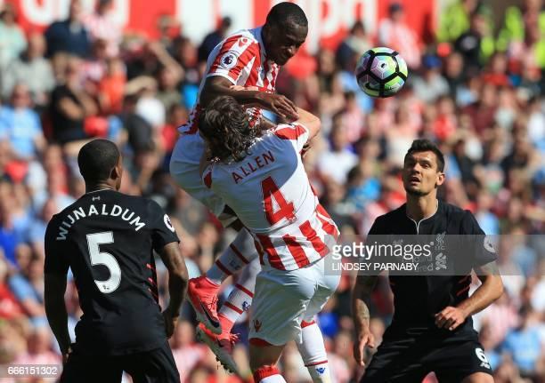 Stoke City's English striker Saido Berahino and Stoke City's Welsh midfielder Joe Allen clash during the English Premier League football match...
