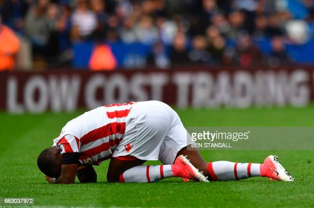 Stoke City's English striker Saido Berahino lies on the pitch hurt during the English Premier League football match between Leicester City and Stoke...