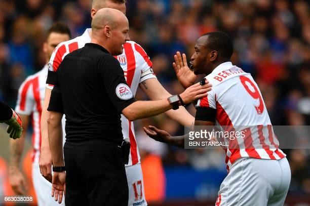 Stoke City's English striker Saido Berahino talks with the referee during the English Premier League football match between Leicester City and Stoke...