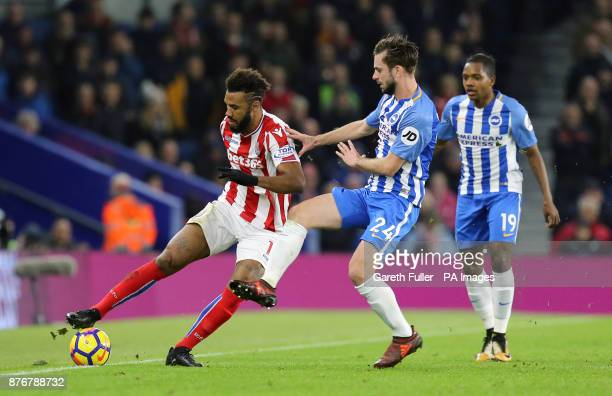 Stoke City's Eric Maxim ChoupoMoting and Brighton Hove Albion's Davy Propper battle for the ball during the Premier League match at the AMEX Stadium...