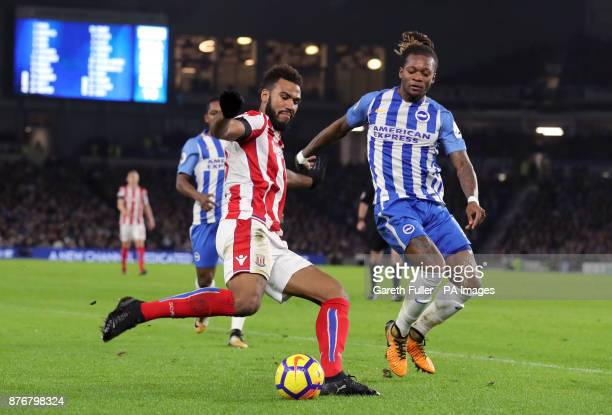 Stoke City's Eric Maxim ChoupoMoting and Brighton Hove Albion's Gaetan Bong battle for the ball during the Premier League match at the AMEX Stadium...