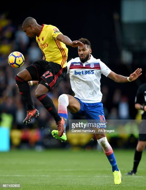 Stoke City's Eric Maxim ChoupoMoting and Watford's Christian Kabasele battle for the ball during the Premier League match at Vicarage Road Watford