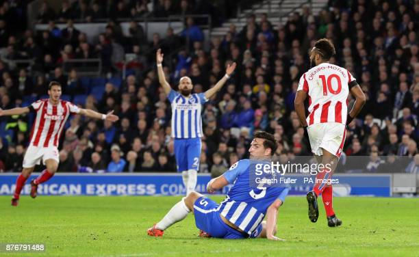 Stoke City's Eric Maxim ChoupoMoting celebrates scoring his side's first goal of the game as Brighton Hove Albion's Lewis Dunk reacts during the...