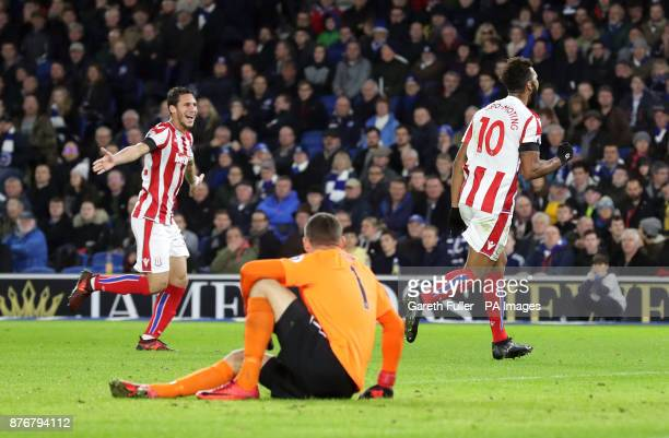 Stoke City's Eric Maxim ChoupoMoting celebrates scoring his side's first goal of the game as Brighton Hove Albion goalkeeper Mathew Ryan sits...