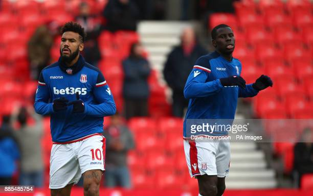 Stoke City's Eric Maxim ChoupoMoting left and Stoke City's Kurt Zouma warm up during the Premier League match at the Bet35 Stadium StokeonTrent