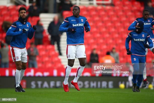 Stoke City's Eric Maxim ChoupoMoting left Stoke City's Kurt Zouma and Stoke City's Jese warm up during the Premier League match at the Bet35 Stadium...