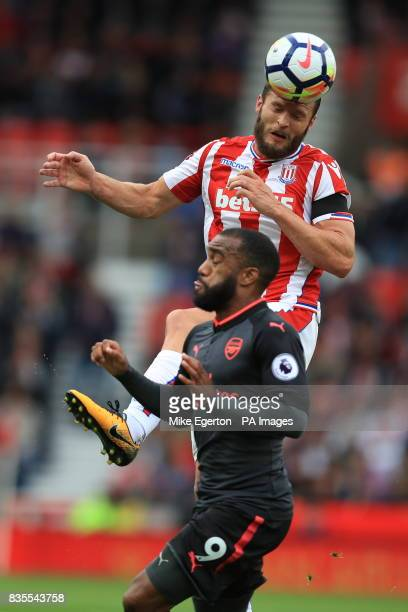 Stoke City's Erik Pieters and Arsenal's Alexandre Lacazette battle for the ball during the Premier League match at the bet365 Stadium Stoke