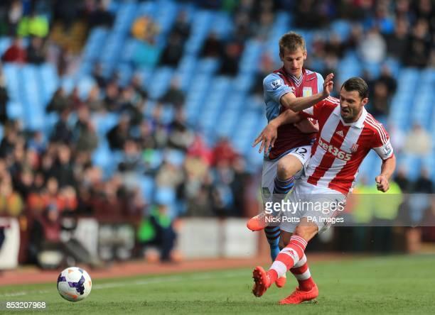 Stoke City's Erik Pieters and Aston Villa's Marc Albrighton battle for the ball