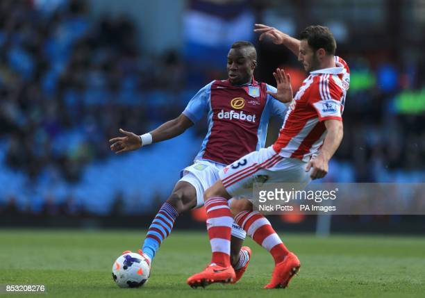 Stoke City's Erik Pieters and Aston Villa's Yacouba Sylla battle for the ball