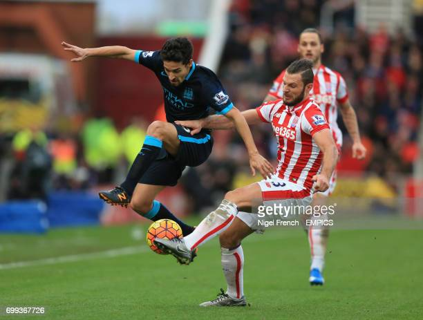 Stoke City's Erik Pieters and Manchester City's Jesus Navas battle for the ball