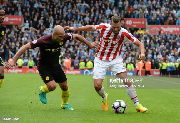 Stoke City's Erik Pieters holds off a challenge from Manchester City's Pablo Zabaleta