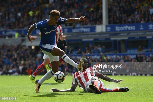 Stoke City's French defender Kurt Zouma blocks a shot from Everton's English striker Dominic CalvertLewin during the English Premier League football...
