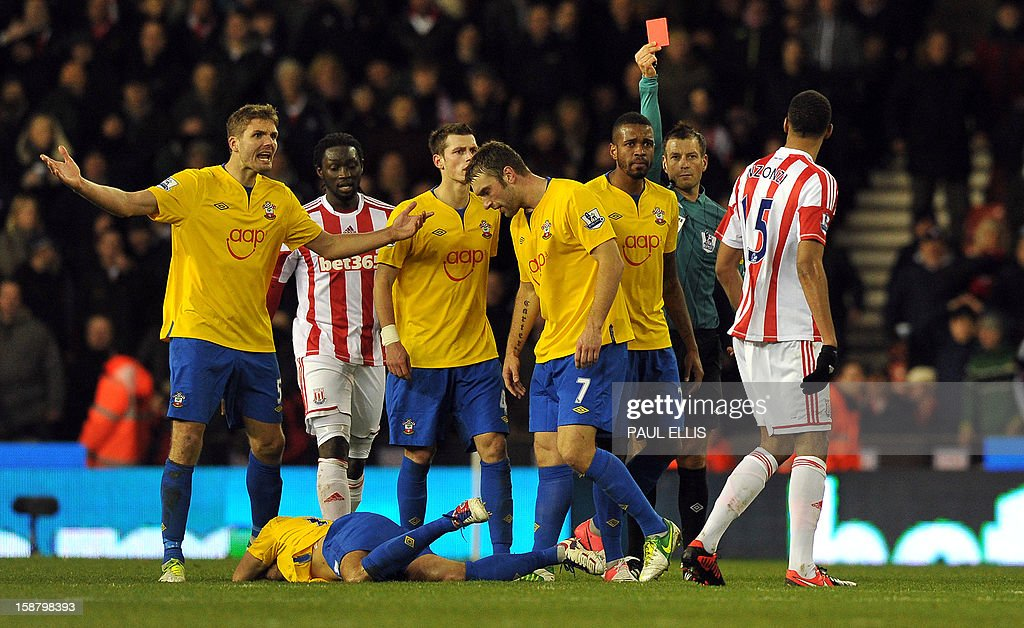 "Stoke City's French midfielder Steven N'Zonzi (R) is shown a red card by referee Mark Clattenburg (2nd R) after a foul on Southampton's English midfielder Jack Cork (Left on floor) during the English Premier League football match between Stoke City and Southampton at The Britannia stadium, Stoke-on-Trent, England, on December 29, 2012. The game ended 3-3. USE. No use with unauthorized audio, video, data, fixture lists, club/league logos or ""live"" services. Online in-match use limited to 45 images, no video emulation. No use in betting, games or single club/league/player publications."