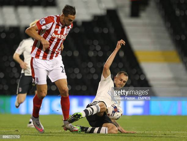Stoke City's Geoff Cameron and Fulham's Sakari Mattila battle for the ball