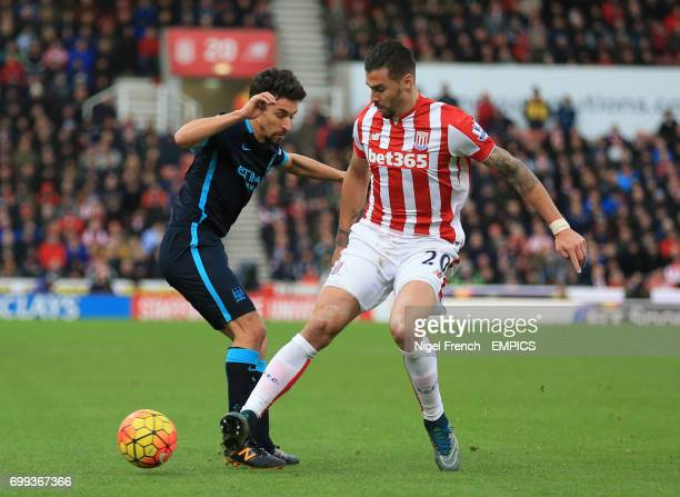 Stoke City's Geoff Cameron and Manchester City's Jesus Navas battle for the ball