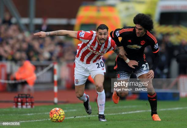 Stoke City's Geoff Cameron and Manchester United's Marouane Fellaini battle for the ball
