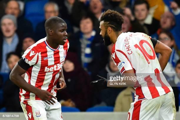 Stoke City's German midfielder Eric Maxim ChoupoMoting and Stoke City's French defender Kurt Zouma do a celebratory dance after Zouma scored their...
