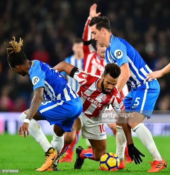 Stoke City's German midfielder Eric Maxim ChoupoMoting battles with Brighton's Cameroonian defender Gaetan Bong and Brighton's English defender Lewis...