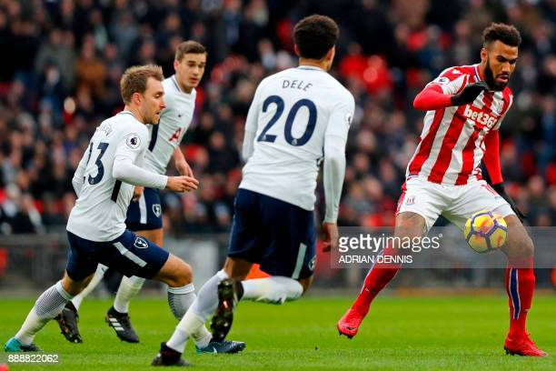 Stoke City's German midfielder Eric Maxim ChoupoMoting controls the ball as Tottenham Hotspur's Danish midfielder Christian Eriksen Tottenham...