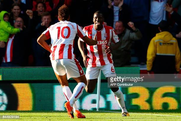 Stoke City's German midfielder Eric Maxim ChoupoMoting does a celebratory dance with Stoke City's French defender Kurt Zouma after scoring his team's...