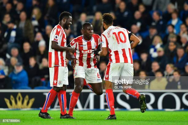 Stoke City's German midfielder Eric Maxim ChoupoMoting does a celebratory dance with Stoke City's French defender Kurt Zouma after scoring the...