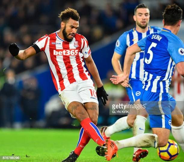 Stoke City's German midfielder Eric Maxim ChoupoMoting scores the opening goal during the English Premier League football match between Brighton and...