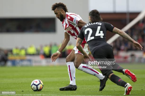 Stoke City's German midfielder Eric Maxim ChoupoMoting vies with Arsenal's Spanish defender Hector Bellerin during the English Premier League...