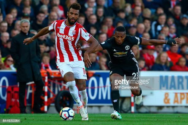 Stoke City's German midfielder Eric Maxim ChoupoMoting vies with Manchester United's Ecuadorian midfielder Antonio Valencia during the English...
